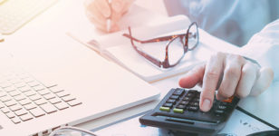 laptop-and-calculator-Care-fees-healthcare-lawyers-bournemouth