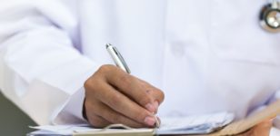 doctor-doing-paperwork-healthcare-lawyers-bournemouth