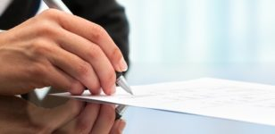 man-signing-paper-corporate-solicitors-bournemouth