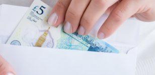 five-pound-note-in-white-envelope-inheritance-money