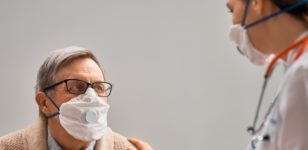 two-people-wearing-masks-infection-control