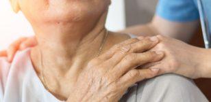 elderly-lady-holding-carers-hand